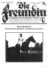 "Reproduction of a German magazine cover with the title ""Die Freundin"" showing a nude woman sitting on a horse, looking behind her"