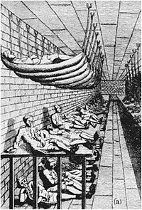 A drawing of a large room, with three long tiers of beds next to the left wall, with men lying in them. The top tier consists of hammocks attached by ropes to ceiling bolts. The middle tier appears to be one large flat wooden platform. The lower tier consists of men lying on the bare floor.