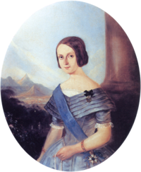 Half-length painted portrait of a smiling young woman in early Victorian blue formal gown wearing a blue sash of office over one shoulder