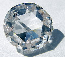 A colorless faceted gem
