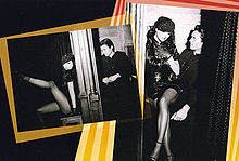 A collage of two black-and-white images with brighty colored borders in a black background. The first picture features a brunette woman, wearing a black dress and fishnet stockings and leaning suggestively against a confessional. A young priest sits on the other side of the partition. The second image shows the same brunette woman sitting on the priest's lap.
