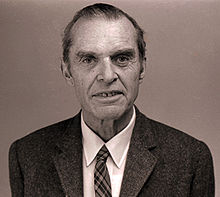Head and shoulders of elderly man in suit and tie