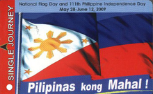 "A card with the words ""single journey"" in a red rectangle going down the left side taking about 10% of it and the rest showing a drawing of a wavy flag containing a white triangle with stylized sun and stars on a field of blue and red. Above the flag is a reference to National Flag Day and the 111th Philippine Independence Day and corresponding dates. Underneath are the words ""Pilipinas kong Mahal!"" (My Beloved Philippines)."