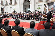 Color image of Los 33 miners attending a ceremony hosted by President Piñera at the Presidential Palace on 24 October 2010 after their rescue from the San Jose Mine