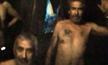 slightly grainy color video capture image showing the dirty and sweaty, slightly malnourished condition of the miners