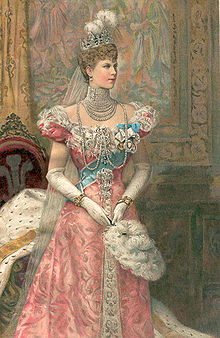 Thin lady wearing a formal dress, a rope of pearls and a tiara