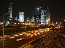 Night time picture of Ramat Gan showing many skyscrapers illuminating the city skyline