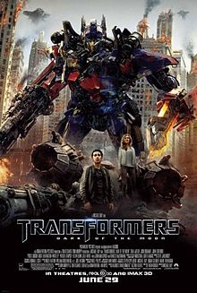 The poster depicts of a Transformer named Optimus Prime, standing with his blade on his left arm, and his blaster on his right arm, with a young couple standing below the Transformer, and standing in front of a crashlanded Decepticon fighter. The characters appear to be in the war-torn city of Chicago, with Decepticon battleships surrounding and guarding the city. The film title and credits are on the bottom of the poster.