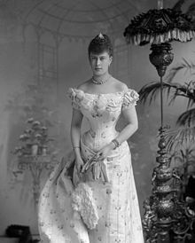 Young lady in a tightly-corseted dress