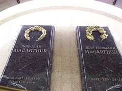 "Two black granite slabs inscribed with the names ""Douglas MacArthur"" and ""Jean Faircloth MacArthur"""