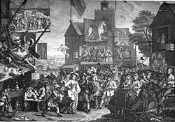 A crowded street populated by characters in 18th century dress.