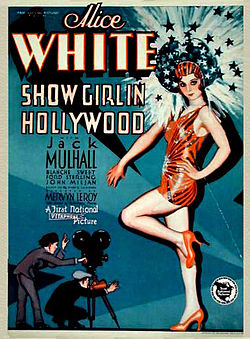 Movie poster featuring a large illustration of a young woman wearing a short orange-red dance outfit, high heels, and headdress. Her head is surrounded by shooting stars and sparkles. At her feet, much smaller-scaled, are two men—one is shouting through a megaphone, the other is operating a movie camera. The accompanying text is dominated by the name of star Alice White.