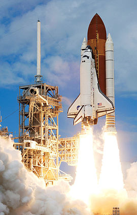 Space Shuttle Discovery begins liftoff at the start of STS-120.